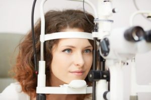 young woman taking eye care